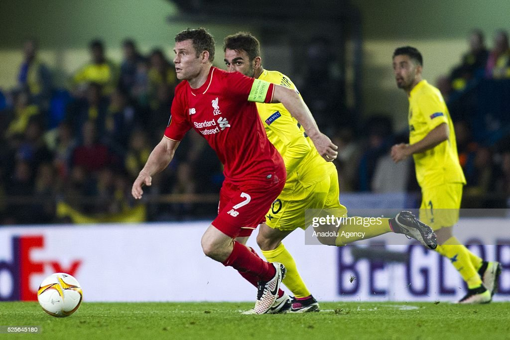 James Milner (L) of Liverpool in action during the UEFA Europa League Semi Final match between Villarreal and Liverpool at Estadio El Madrigal in Villareal, Spain on April 28, 2016.