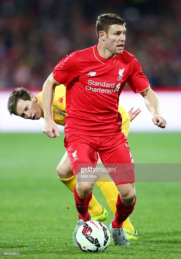 <a gi-track='captionPersonalityLinkClicked' href=/galleries/search?phrase=James+Milner&family=editorial&specificpeople=214576 ng-click='$event.stopPropagation()'>James Milner</a> of Liverpool is challenged by <a gi-track='captionPersonalityLinkClicked' href=/galleries/search?phrase=Craig+Goodwin&family=editorial&specificpeople=8749472 ng-click='$event.stopPropagation()'>Craig Goodwin</a> of United during the international friendly match between Adelaide United and Liverpool FC at Adelaide Oval on July 20, 2015 in Adelaide, Australia.