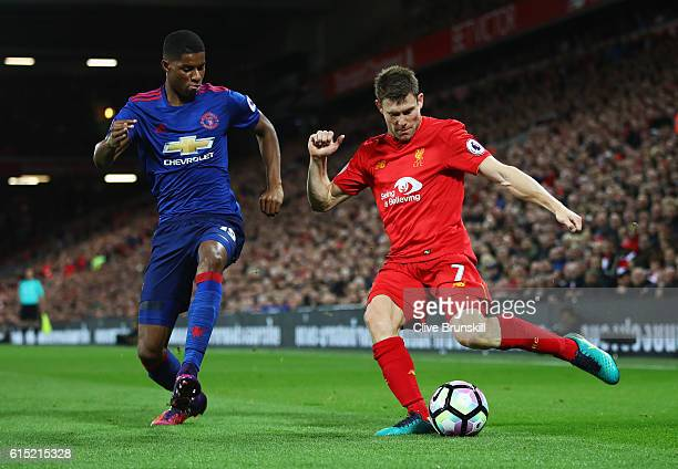 James Milner of Liverpool is closed down by Marcus Rashford of Manchester United during the Premier League match between Liverpool and Manchester...