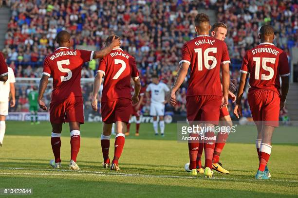 James Milner of Liverpool puts them into the lead from the penalty Spot and Celebrates during the pre season friendly between Tranmere Rovers and...