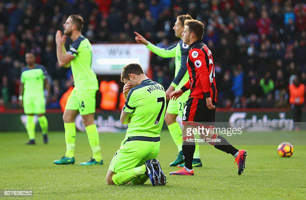 James Milner of Liverpool reacts as he concedes a penalty during the Premier League match between AFC Bournemouth and Liverpool at Vitality Stadium...