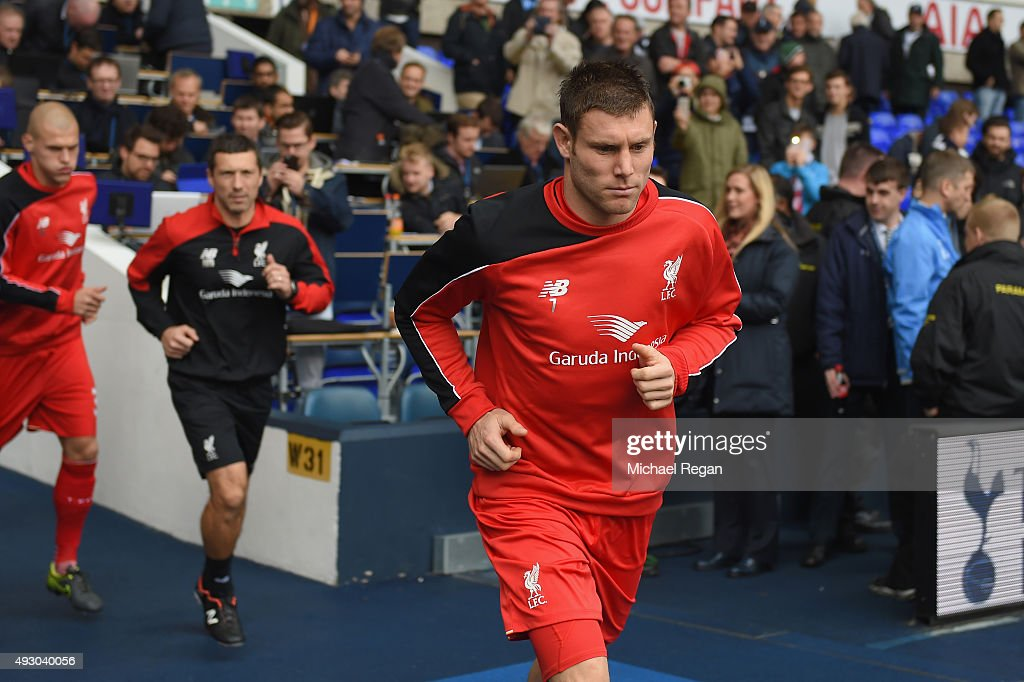 <a gi-track='captionPersonalityLinkClicked' href=/galleries/search?phrase=James+Milner&family=editorial&specificpeople=214576 ng-click='$event.stopPropagation()'>James Milner</a> of Liverpool runs into the pitch for the warm-up prior to the Barclays Premier League match between Tottenham Hotspur and Liverpool at White Hart Lane on October 17, 2015 in London, England.