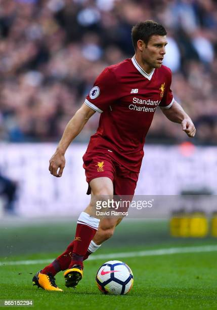 James Milner of Liverpool runs with the ball during the Premier League match between Tottenham Hotspur and Liverpool at Wembley Stadium on October 22...