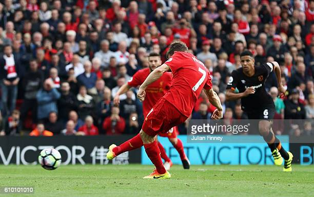 James Milner of Liverpool scores his sides second goal during the Premier League match between Liverpool and Hull City at Anfield on September 24...