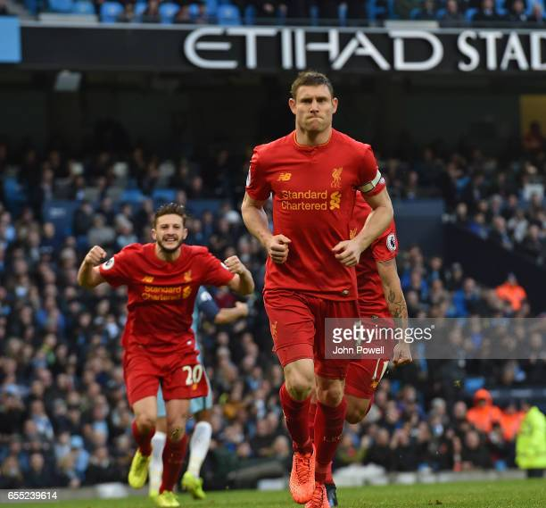 James MIlner of Liverpool scores the opener from the penalty spot and celebrates during the Premier League match between Manchester City and...
