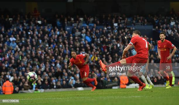 James MIlner of Liverpool scores the opener from the penalty spot during the Premier League match between Manchester City and Liverpool at Etihad...