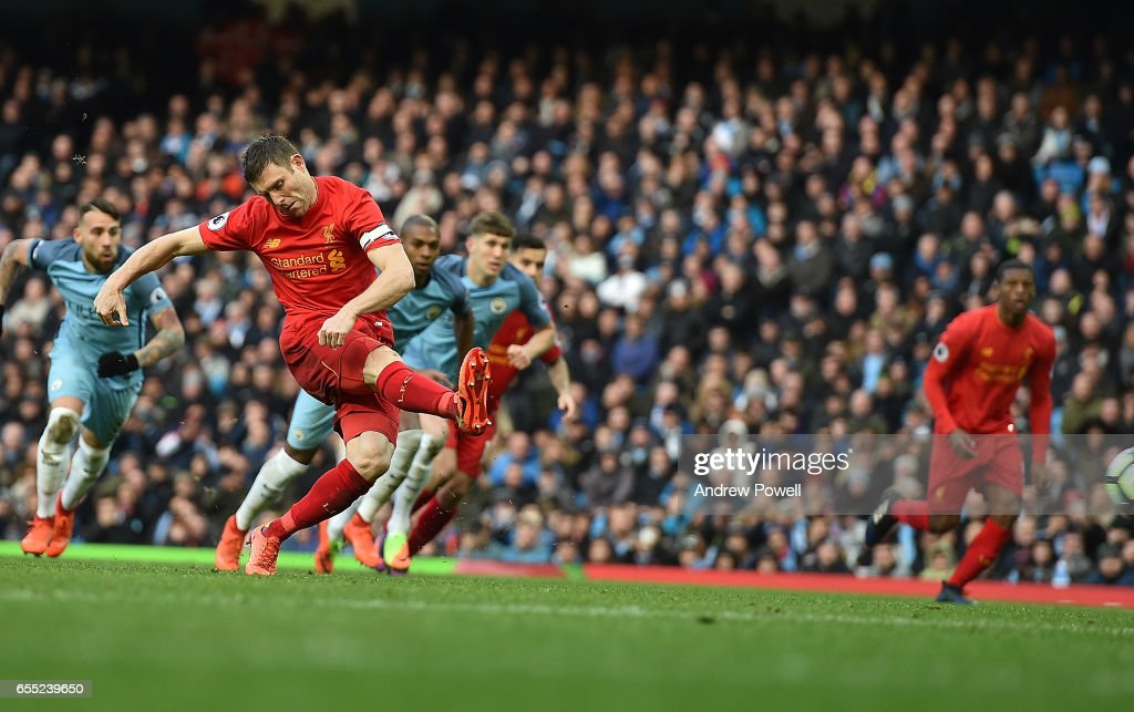 James MIlner of Liverpool scores the opener from the penalty spot during the Premier League match between Manchester City and Liverpool at Etihad Stadium on March 19, 2017 in Manchester, England.
