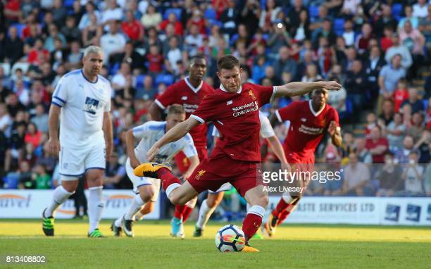 James Milner of Liverpool scores the opening goal from the penalty spot during a preseason friendly match between Tranmere Rovers and Liverpool at...