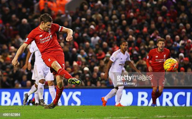 James Milner of Liverpool scores their first goal from a penalty during the Barclays Premier League match between Liverpool and Swansea City at...