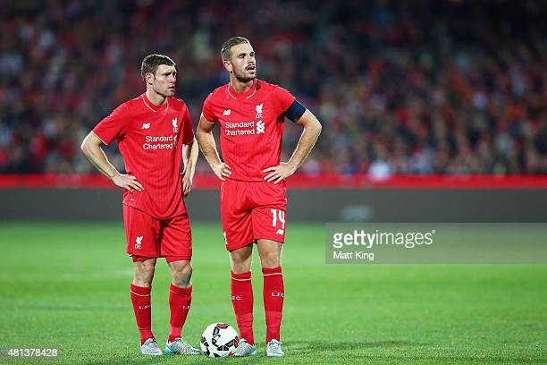 James Milner of Liverpool talks to Jordan Henderson of Liverpool during the international friendly match between Adelaide United and Liverpool FC at...