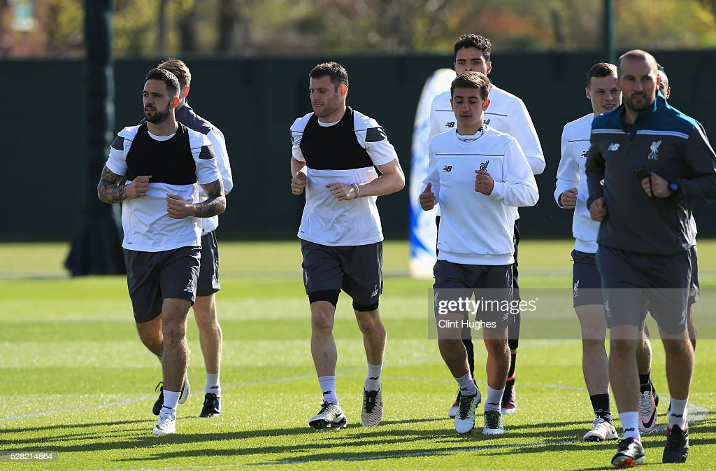 <a gi-track='captionPersonalityLinkClicked' href=/galleries/search?phrase=James+Milner&family=editorial&specificpeople=214576 ng-click='$event.stopPropagation()'>James Milner</a> (2ndL) of Liverpool warms up with <a gi-track='captionPersonalityLinkClicked' href=/galleries/search?phrase=Danny+Ings&family=editorial&specificpeople=10650941 ng-click='$event.stopPropagation()'>Danny Ings</a> (L) during a training session ahead of the UEFA Europa League Semi-Final Second Leg match against Villarreal at Melwood Training Ground on May 4, 2016 in Liverpool, England.