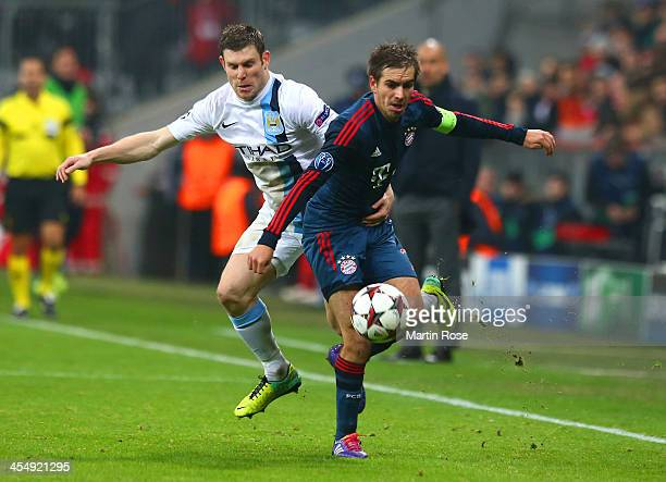 James Milner of Manchester City and Philipp Lahm of Bayern Muenchen battle for the ball during the UEFA Champions League Group D match between FC...