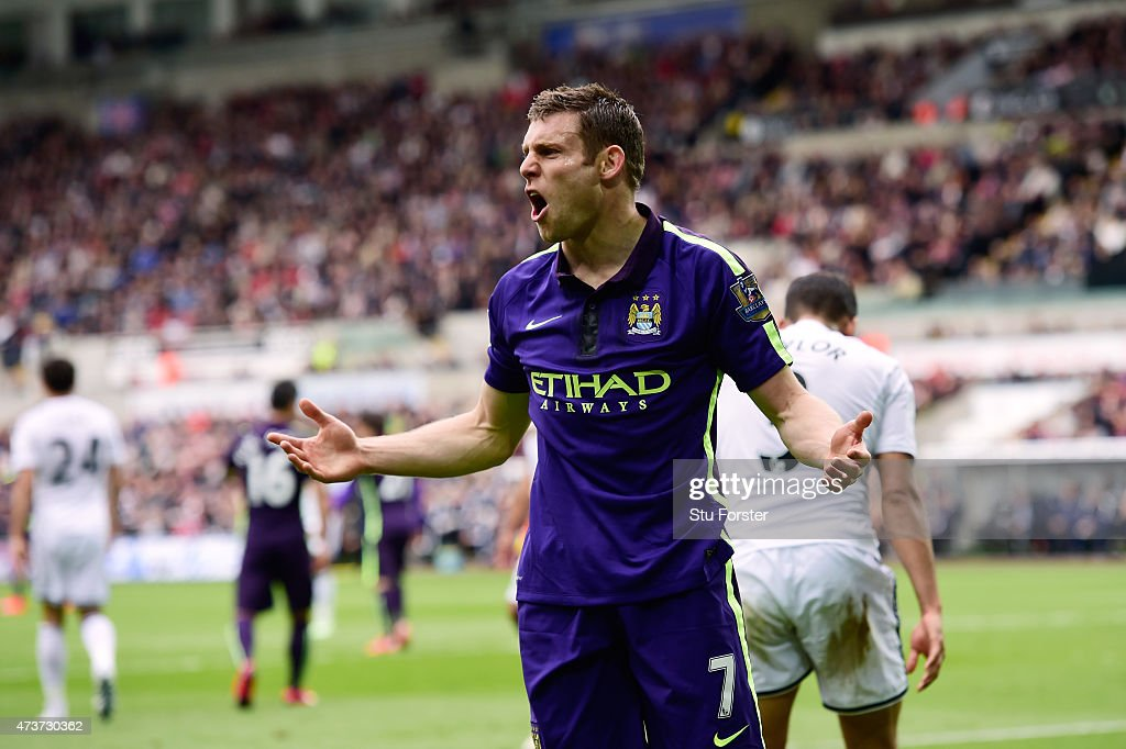 <a gi-track='captionPersonalityLinkClicked' href=/galleries/search?phrase=James+Milner&family=editorial&specificpeople=214576 ng-click='$event.stopPropagation()'>James Milner</a> of Manchester City celebrates after scoring his team's second goal during the Barclays Premier League match between Swansea and Manchester City at the Liberty Stadium on May 17, 2015 in Swansea, Wales.