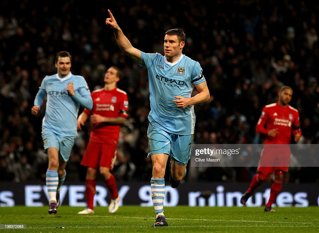 <a gi-track='captionPersonalityLinkClicked' href=/galleries/search?phrase=James+Milner&family=editorial&specificpeople=214576 ng-click='$event.stopPropagation()'>James Milner</a> of Manchester City celebrates scoring his team's third goal, from a penalty kick, during the Barclays Premier League match between Manchester City and Liverpool at the Etihad Stadium on January 3, 2012 in Manchester, England.