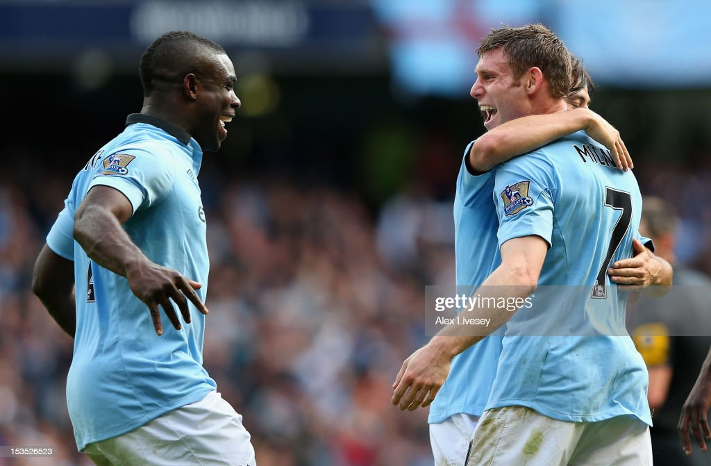 <a gi-track='captionPersonalityLinkClicked' href=/galleries/search?phrase=James+Milner&family=editorial&specificpeople=214576 ng-click='$event.stopPropagation()'>James Milner</a> of Manchester City celebrates scoring his team's third goal with team-mate <a gi-track='captionPersonalityLinkClicked' href=/galleries/search?phrase=Micah+Richards&family=editorial&specificpeople=647038 ng-click='$event.stopPropagation()'>Micah Richards</a> (L) during the Barclays Premier League match between Manchester City and Sunderland at the Etihad Stadium on October 6, 2012 in Manchester, England.