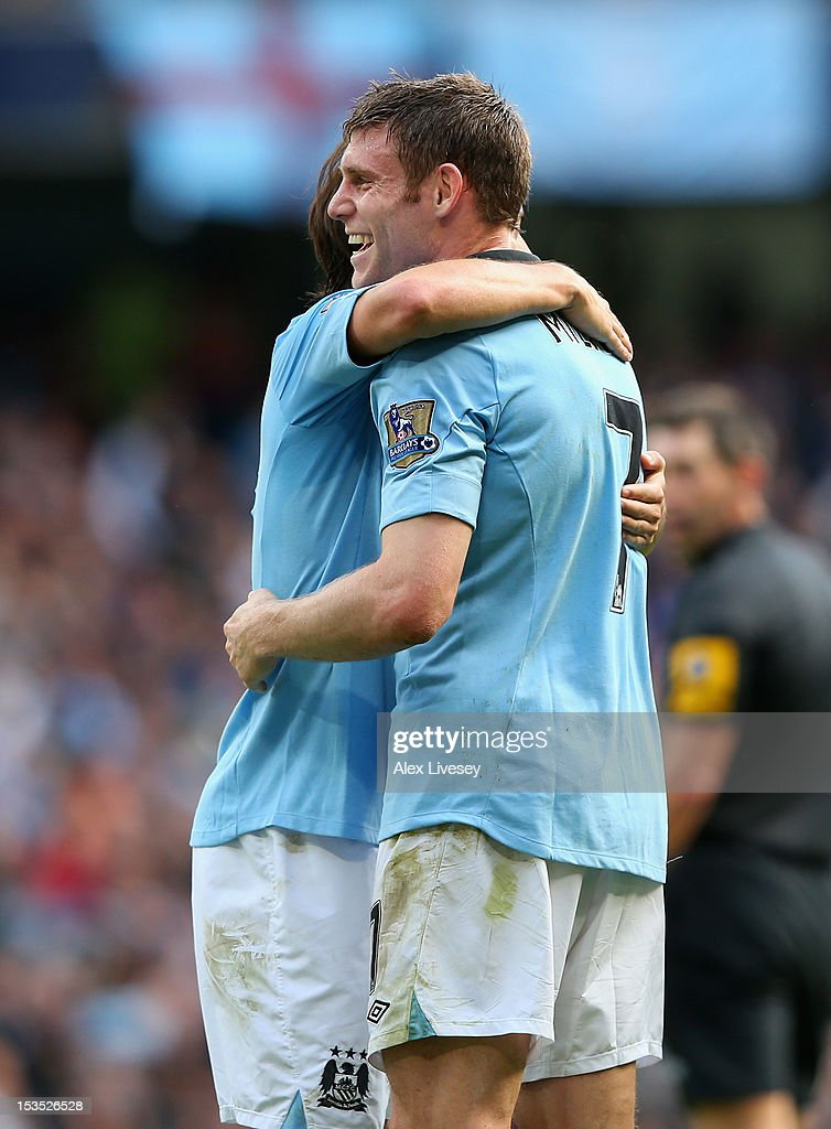 James Milner of Manchester City celebrates scoring his team's third goal during the Barclays Premier League match between Manchester City and Sunderland at the Etihad Stadium on October 6, 2012 in Manchester, England.