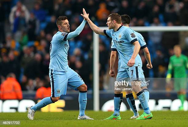 James Milner of Manchester City celebrates scoring the equalising goal with teammate Stevan Jovetic during the Barclays Premier League match between...