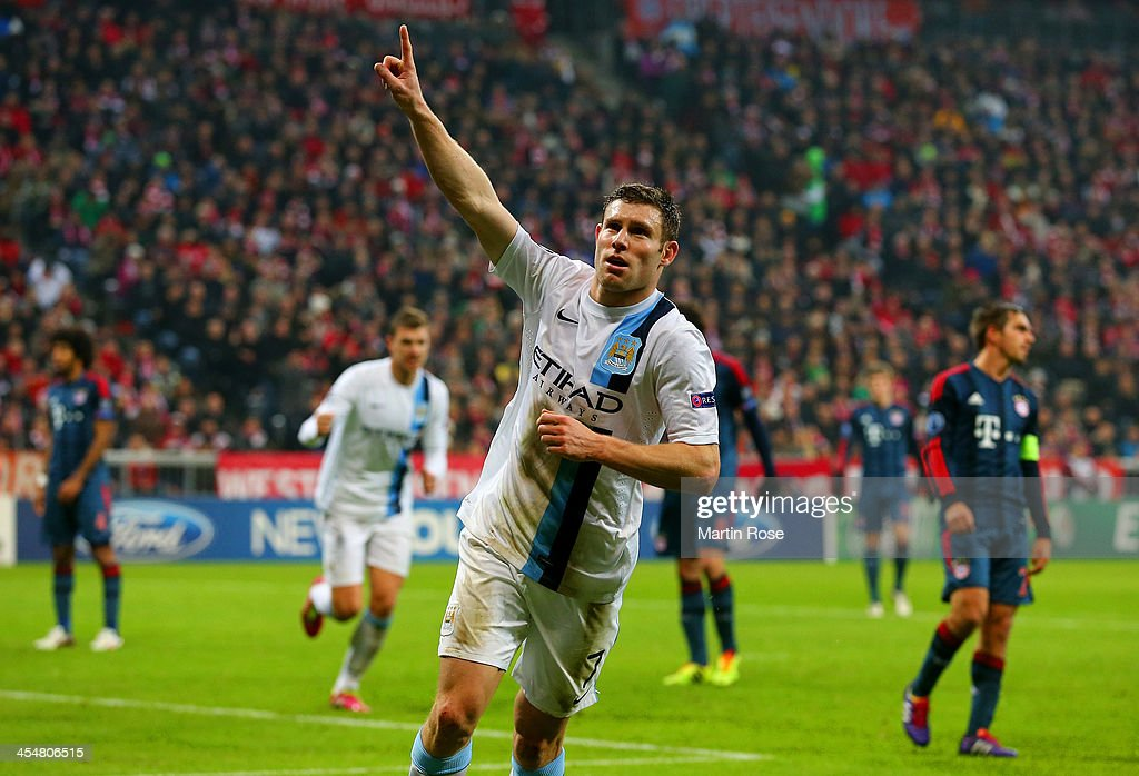 <a gi-track='captionPersonalityLinkClicked' href=/galleries/search?phrase=James+Milner&family=editorial&specificpeople=214576 ng-click='$event.stopPropagation()'>James Milner</a> of Manchester City celebrates scoring their third goal during the UEFA Champions League Group D match between FC Bayern Muenchen and Manchester City at the Allianz Arena December 10, 2013 in Munich, Germany.
