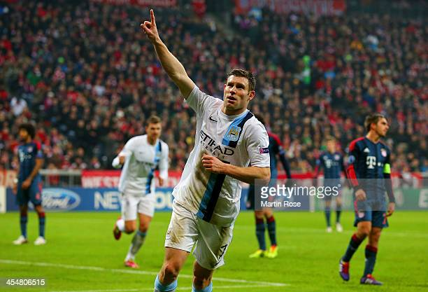 James Milner of Manchester City celebrates scoring their third goal during the UEFA Champions League Group D match between FC Bayern Muenchen and...