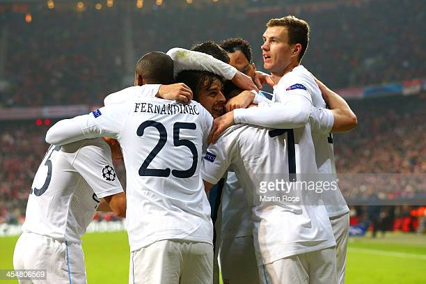 James Milner of Manchester City celebrates scoring their third goal with team mates during the UEFA Champions League Group D match between FC Bayern...
