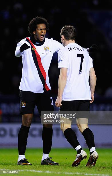James Milner of Manchester City celebrates with team mate Jo Silva after scoring during the FA Cup sponsored by EON 3rd Round match between between...