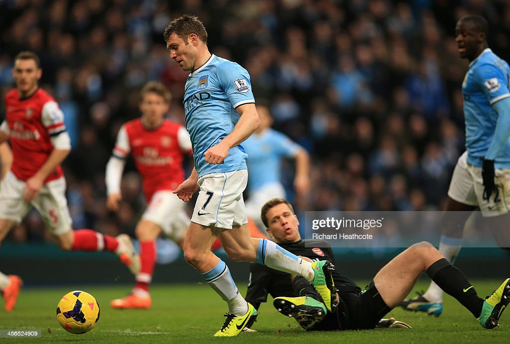 <a gi-track='captionPersonalityLinkClicked' href=/galleries/search?phrase=James+Milner+-+Soccer+Player&family=editorial&specificpeople=214576 ng-click='$event.stopPropagation()'>James Milner</a> of Manchester City is brought down for a penalty by <a gi-track='captionPersonalityLinkClicked' href=/galleries/search?phrase=Wojciech+Szczesny&family=editorial&specificpeople=6539507 ng-click='$event.stopPropagation()'>Wojciech Szczesny</a> of Arsenal during the Barclays Premier League match between Manchester City and Arsenal at Etihad Stadium on December 14, 2013 in Manchester, England.