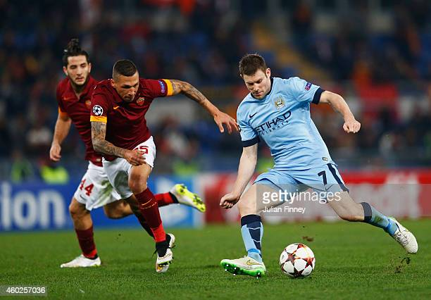 James Milner of Manchester City is watched by Jose Holebas of AS Roma during the UEFA Champions League Group E match between AS Roma and Manchester...