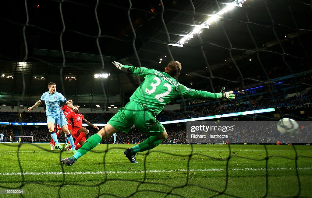 James Milner of Manchester City scores his team's second goal past goalkeeper Mark Schwarzer of Leicester City during the Barclays Premier League match between Manchester City and Leicester City at the Etihad Stadium on March 4, 2015 in Manchester, England.