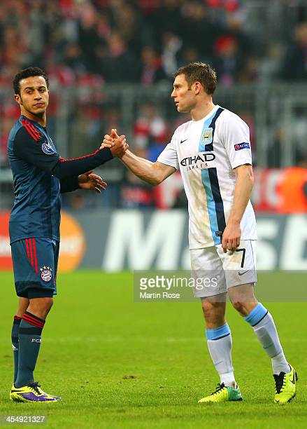 James Milner of Manchester City shakes hands with Thiago Alcantara of Bayern Muenchen at the final whistle during the UEFA Champions League Group D...