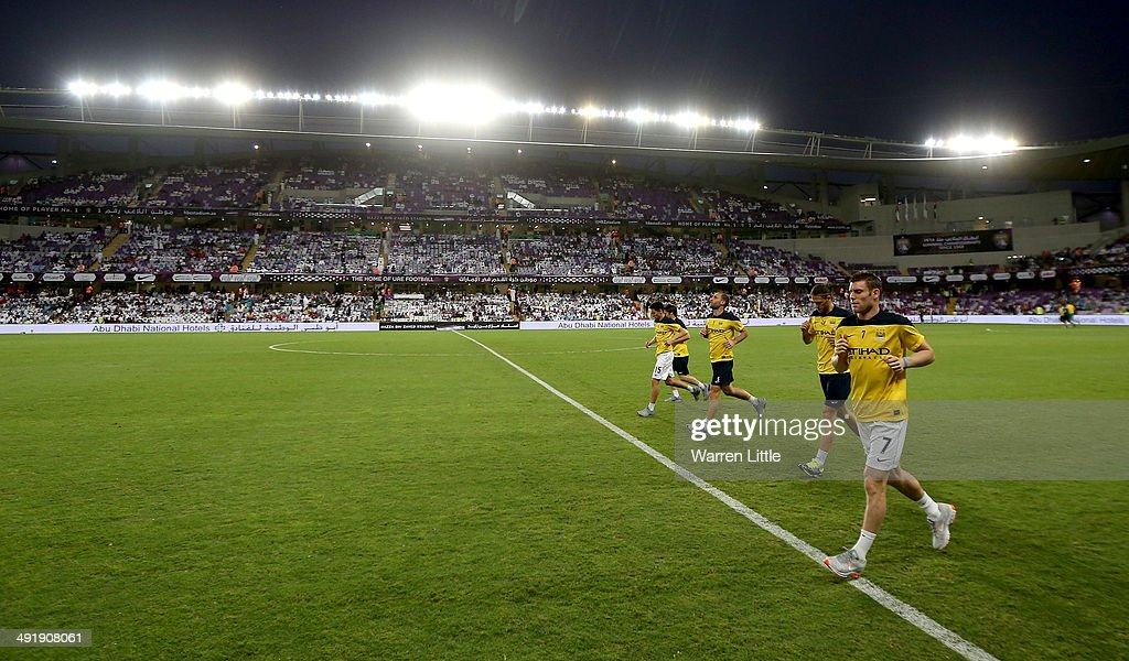 James Milner of Manchester City warms up on the sidelines ahead of the friendly match between Al Ain and Manchester City at Hazza bin Zayed Stadium on May 15, 2014 in Al Ain, United Arab Emirates.