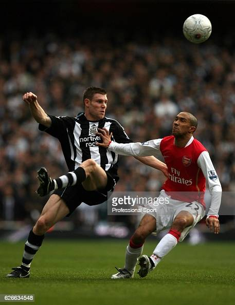 James Milner of Newcastle hooks the ball over the head of Gael Clichy of Arsenal during the FA cup 4th round tie between Arsenal and Newcastle United...