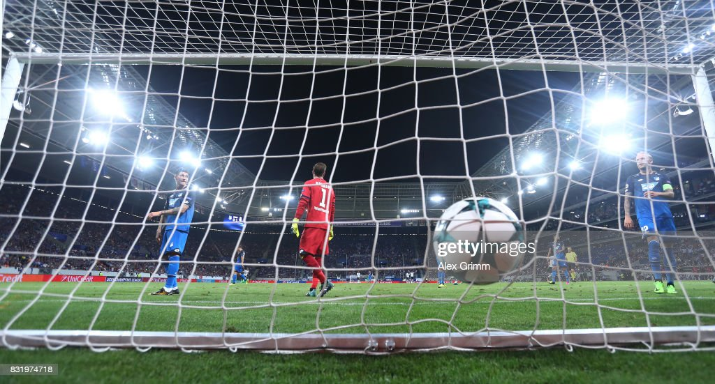 James Milner (not pictured) scores while Oliver Baumann, Lukas Rupp and KEvni Vogt of Hoffenheim look on during the UEFA Champions League Qualifying Play-Offs Round First Leg match between 1899 Hoffenheim and Liverpool FC at Wirsol Rhein-Neckar-Arena on August 15, 2017 in Sinsheim, Germany.
