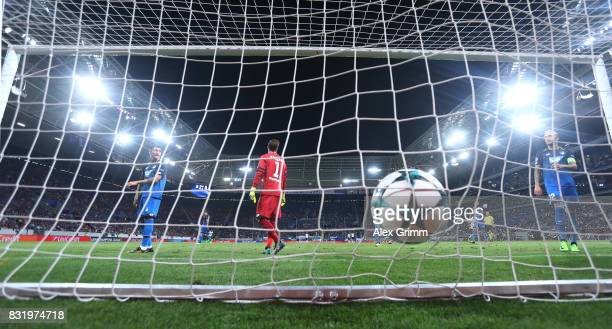 James Milner scores while Oliver Baumann Lukas Rupp and KEvni Vogt of Hoffenheim look on during the UEFA Champions League Qualifying PlayOffs Round...