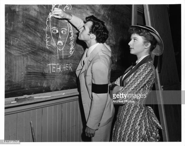 James Mitchell proves to be a difficult pupil for Amanda Blake in between scenes from the film 'Stars In My Crown' 1950