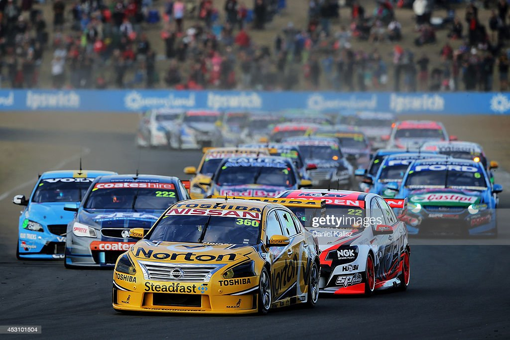 James Moffat drives the #360 Norton Hornets Nissan leads at the start of race 25 for the Ipswich 400, which is round eight of the V8 Supercar Championship Series at Queensland Raceway on August 3, 2014 in Ipswich, Australia.