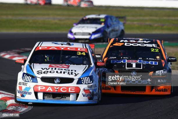 James Moffat drives the Wilson Security Racing GRM Holden Commodore VF leads James Courtney drives the Mobil 1 HSV Racing Holden Commodore VF during...
