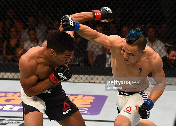James Moontasri punches Kevin Lee in their lightweight bout during the UFC event at the Valley View Casino Center on July 15 2015 in San Diego...