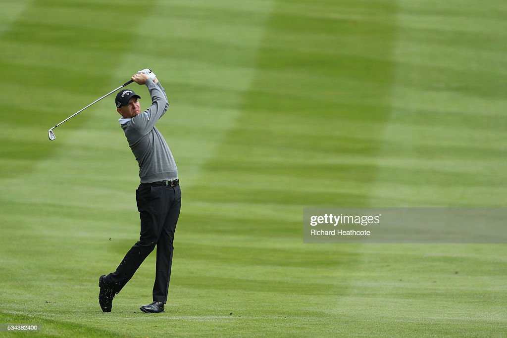 <a gi-track='captionPersonalityLinkClicked' href=/galleries/search?phrase=James+Morrison+-+Golfer&family=editorial&specificpeople=5574243 ng-click='$event.stopPropagation()'>James Morrison</a> of England hits his 2nd shot on the 4th hole during day one of the BMW PGA Championship at Wentworth on May 26, 2016 in Virginia Water, England.