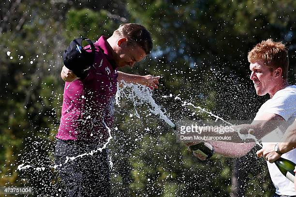 James Morrison of England is sprayed with champange by friends Andrew Dodt of Australia and David Horsey of England after winning the Open de Espana...
