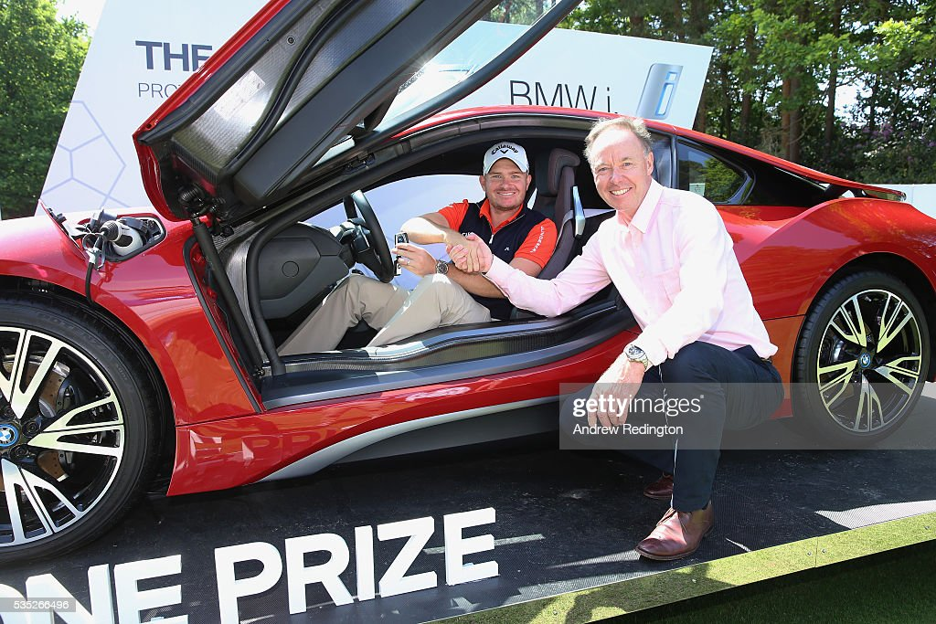 James Morrison of England poses with Dr Ian Robertson, Member of the Board BMW AG Sales and his new BMW i8 car after his hole-in-one on the 14th during day four of the BMW PGA Championship at Wentworth on May 29, 2016 in Virginia Water, England.