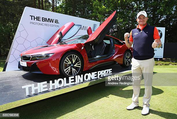 James Morrison of England poses with his new BMW i8 car after his holeinone on the 14th during day four of the BMW PGA Championship at Wentworth on...