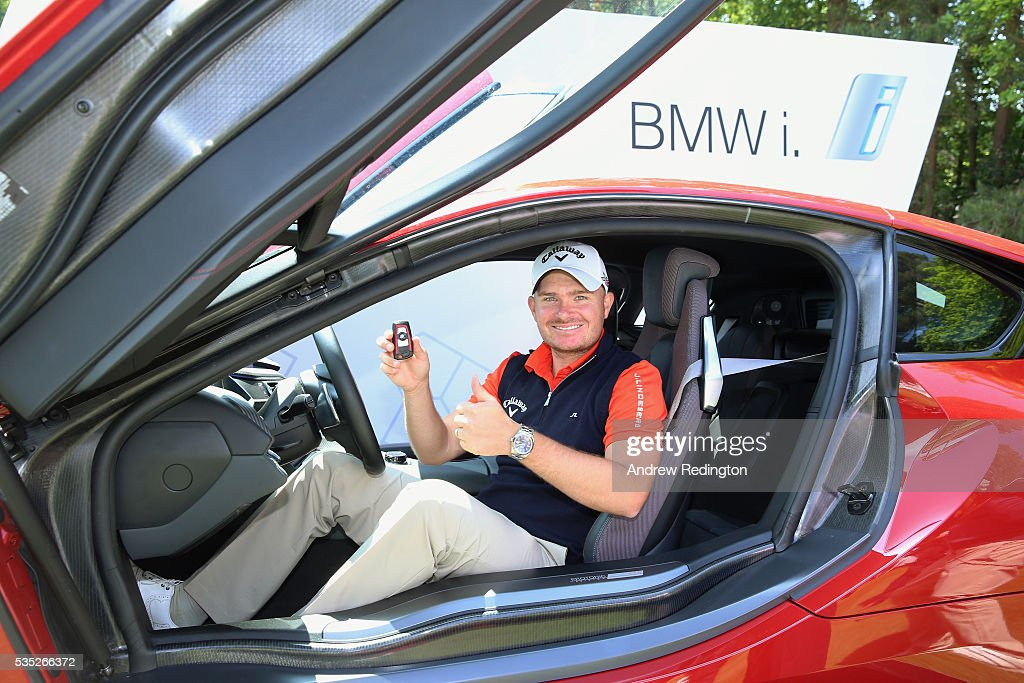<a gi-track='captionPersonalityLinkClicked' href=/galleries/search?phrase=James+Morrison+-+Golfer&family=editorial&specificpeople=5574243 ng-click='$event.stopPropagation()'>James Morrison</a> of England sits in his new BMW i8 car after his hole-in-one on the 14th during day four of the BMW PGA Championship at Wentworth on May 29, 2016 in Virginia Water, England.