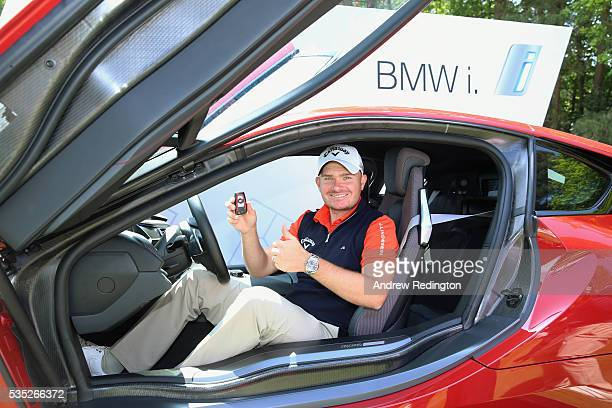 James Morrison of England sits in his new BMW i8 car after his holeinone on the 14th during day four of the BMW PGA Championship at Wentworth on May...