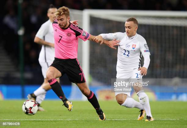 James Morrison of Scotland holds off Stanislav Lobotka of Slovakia during the FIFA 2018 World Cup Group F Qualifier between Scotland and Slovakia at...