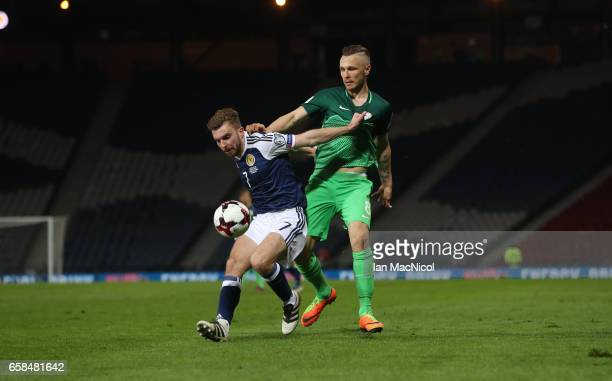James Morrison of Scotland vies with Jasmin Kurtic of Slovinia during the FIFA 2018 World Cup Qualifier between Scotland and Slovenia at Hampden Park...
