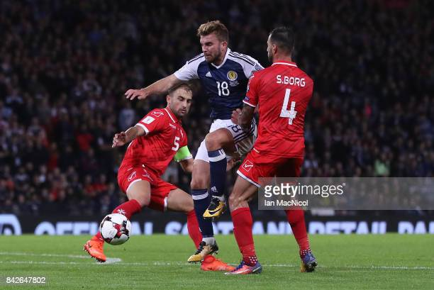 GLASGOW SCOTLAND SEPTEMBER 04 James Morrison of Scotland vies with Steve Borg of Malta during the FIFA 2018 World Cup Qualifier between Scotland and...