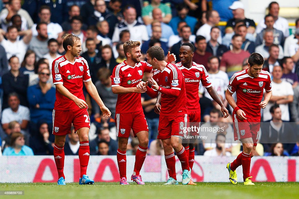 James Morrison of West Brom celebrates with teammates after scoring the opening goal during the Barclays Premier League match between Tottenham...