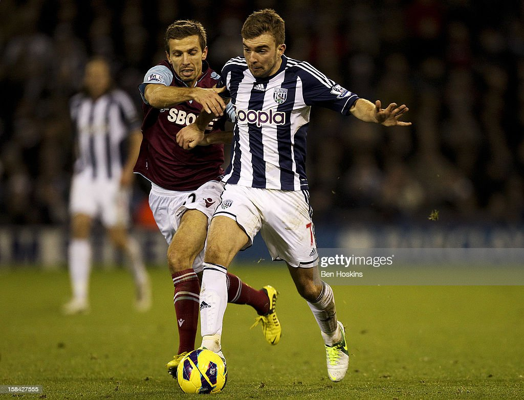 James Morrison of West Brom holds off pressure from <a gi-track='captionPersonalityLinkClicked' href=/galleries/search?phrase=Gary+O%27Neil&family=editorial&specificpeople=683120 ng-click='$event.stopPropagation()'>Gary O'Neil</a> of West Ham during the Barclays Premier League match between West Bromwich Albion and West Ham United at the Hawthorns on December 16, 2012 in West Bromwich, England.