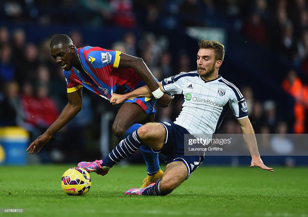 James Morrison of West Brom pulls on the shirt of Yannick Bolasie of Crystal Palace during the Barclays Premier League match between West Bromwich Albion and Crystal Palace at The Hawthorns on October 25, 2014 in West Bromwich, England.