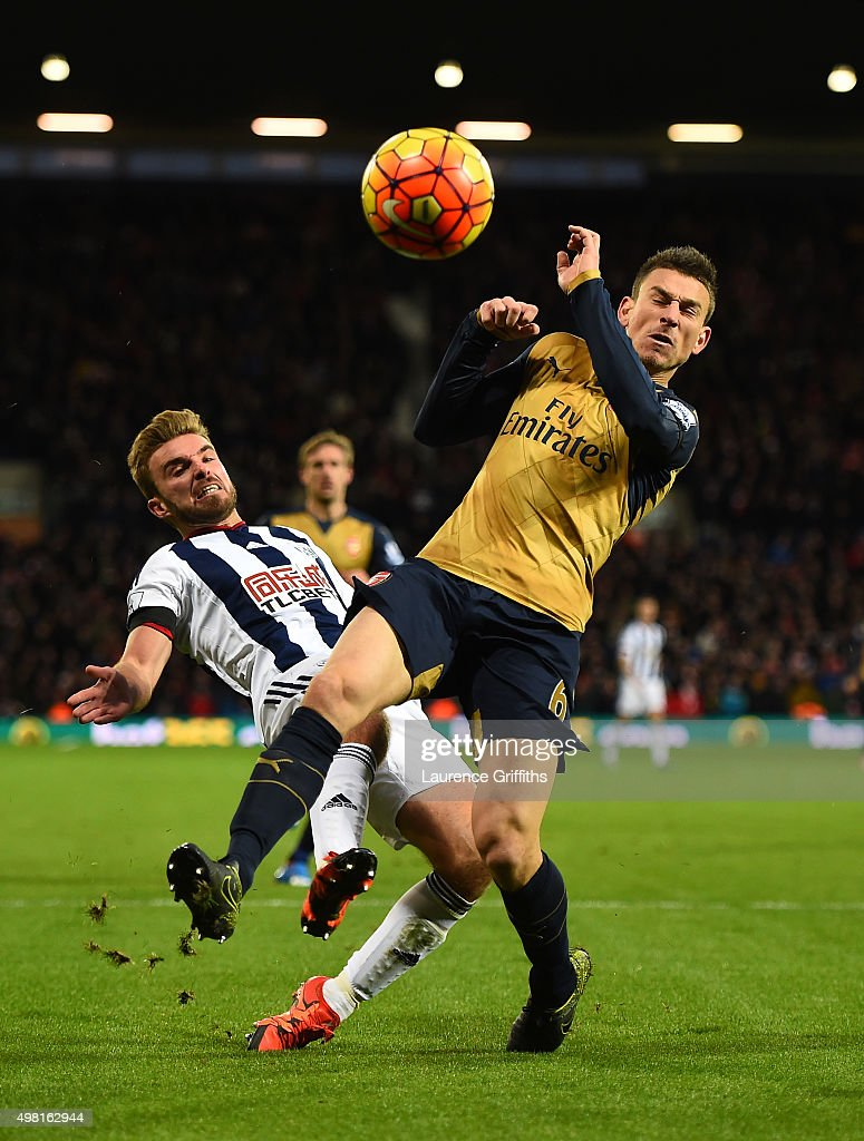 James Morrison of West Bromwich Albion and Laurent Koscielny of Arsenal compete for the ball during the Barclays Premier League match between West Bromwich Albion and Arsenal at The Hawthorns on November 21, 2015 in West Bromwich, England.